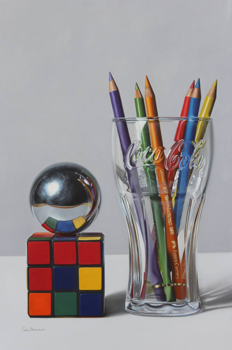 Rubik's cube and glass with pencils