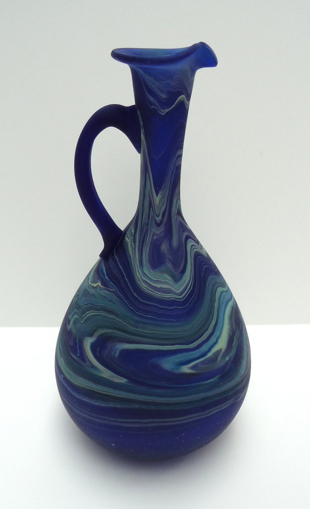 Dark                   blue pitcher with handle