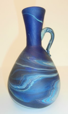 Elongated                   neck one handle vase