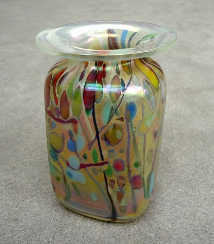 Clear square vase with confetti