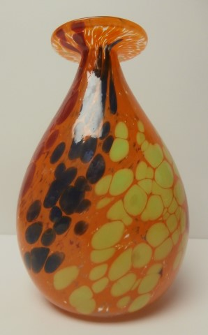 Orange vase with red , blue, and yellow