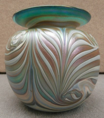 Wide feathered white and green vase with                       green rim