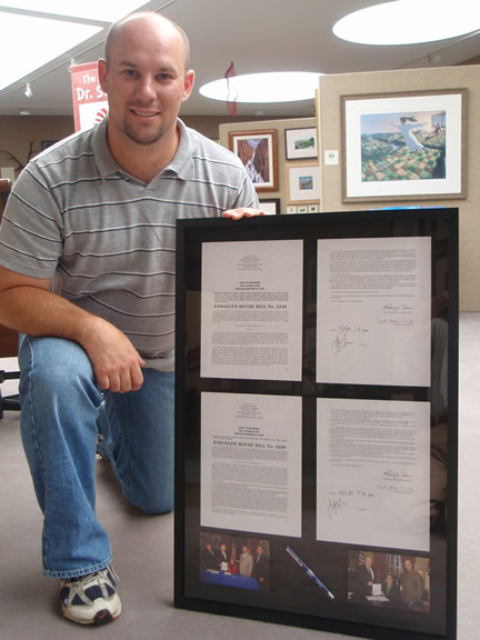 Jared                                 Burkhart bill-signing framing