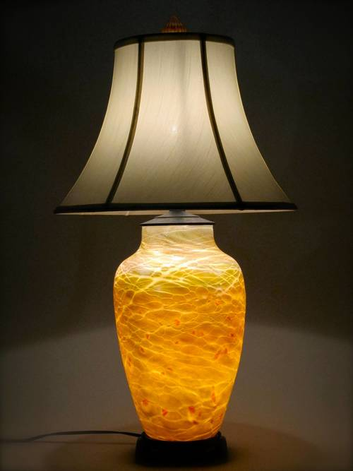 Large lustre                     lamp in gold